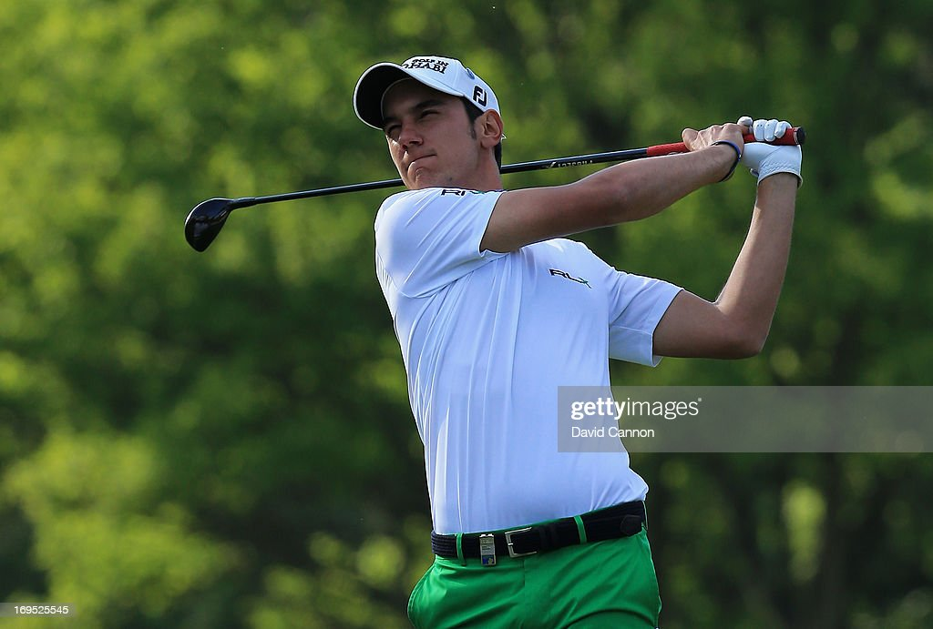 Matteo Manassero of Italy plays his approach on the eighteenth hole in the play-off during the final round of the BMW PGA Championship on the West Course at Wentworth on May 26, 2013 in Virginia Water, England.