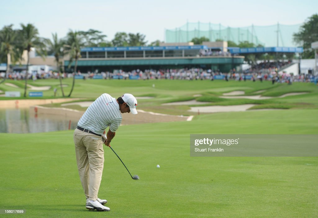 <a gi-track='captionPersonalityLinkClicked' href=/galleries/search?phrase=Matteo+Manassero&family=editorial&specificpeople=4479535 ng-click='$event.stopPropagation()'>Matteo Manassero</a> of Italy plays his approach shot on the 18th hole during the playoff hole after the final round of the Barclays Singapore Open at the Sentosa Golf Club on November 11, 2012 in Singapore.