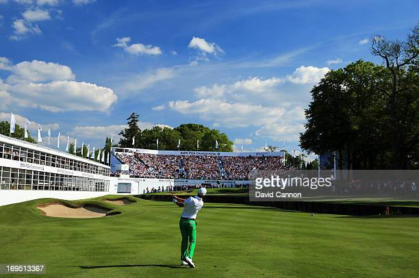 Matteo Manassero of Italy plays his approach to the eighteenth green during the final round of the BMW PGA Championship on the West Course at...