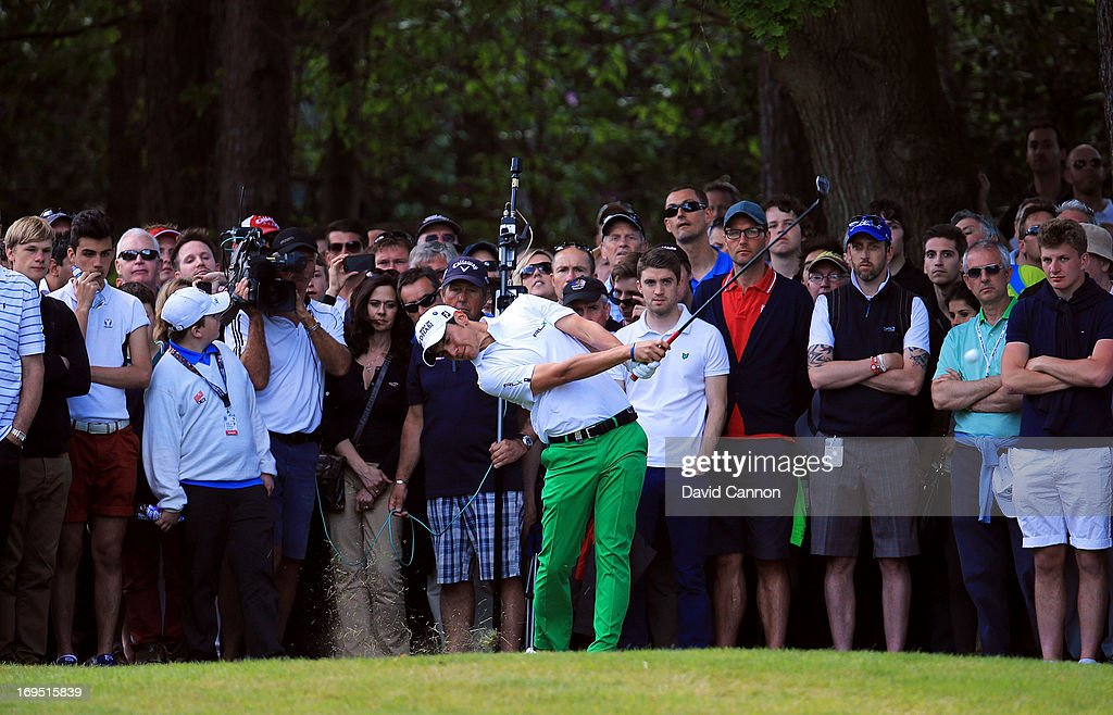 Matteo Manassero of Italy plays his second shot on the fifteenth hole during the final round of the BMW PGA Championship on the West Course at Wentworth on May 26, 2013 in Virginia Water, England.