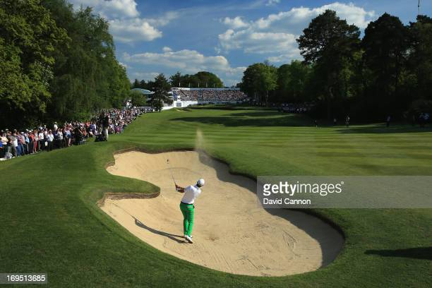 Matteo Manassero of Italy plays his secons shot on the eighteenth hole during the final round of the BMW PGA Championship on the West Course at...