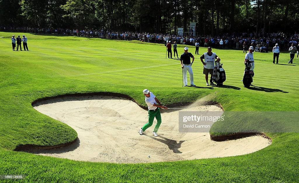 Matteo Manassero of Italy plays his third shot on the fifteenth hole during the final round of the BMW PGA Championship on the West Course at Wentworth on May 26, 2013 in Virginia Water, England.