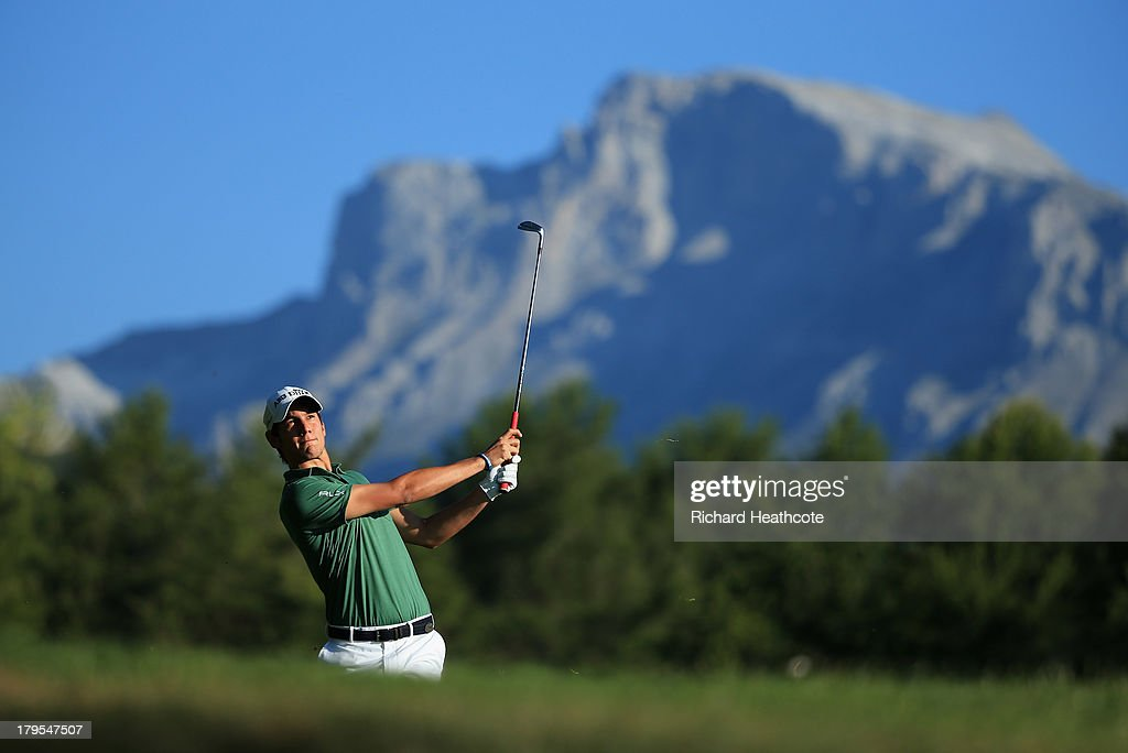 <a gi-track='captionPersonalityLinkClicked' href=/galleries/search?phrase=Matteo+Manassero&family=editorial&specificpeople=4479535 ng-click='$event.stopPropagation()'>Matteo Manassero</a> of Italy plays into the 12th green during the first round of the Omega European Masters at the Crans-sur-Sierre Golf Club on September 5, 2013 in Crans, Switzerland.