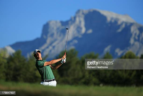 Matteo Manassero of Italy plays into the 12th green during the first round of the Omega European Masters at the CranssurSierre Golf Club on September...