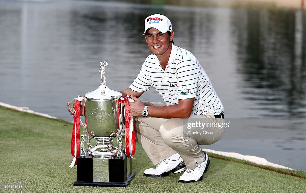 <a gi-track='captionPersonalityLinkClicked' href=/galleries/search?phrase=Matteo+Manassero&family=editorial&specificpeople=4479535 ng-click='$event.stopPropagation()'>Matteo Manassero</a> of Italy poses for photographs with the Barclay's Singapore Open Champion Trophy after winning the playoff during the fourth round of the Barclays Singapore Open at the Sentosa Golf Club on November 11, 2012 in Singapore. Singapore.