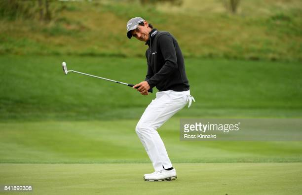Matteo Manassero of Italy reacts Thorbjorn Olesen of Denmark his putt on the 10th green during the third round of the DD REAL Czech Masters at...