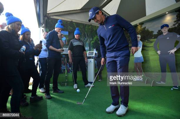 Matteo Manassero of Italy takes part in the Keepy Uppys Challenge at the Zurich sponsor stand during the second day of the British Masters at Close...
