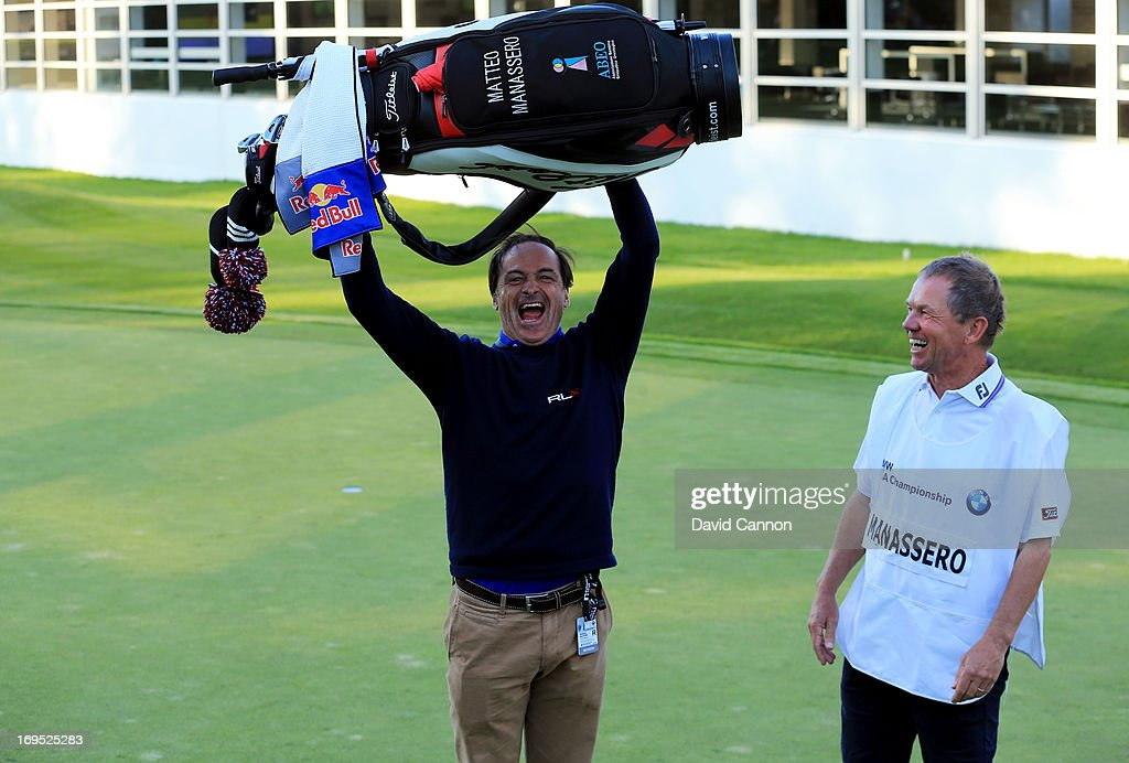 Matteo Manassero's caddy David McNeilly and coach Alberto Binaghi celebrate on the eighteenth green after Manassero won the fourth play-off hole during the final round of the BMW PGA Championship on the West Course at Wentworth on May 26, 2013 in Virginia Water, England.