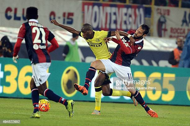Matteo Mancosu of Bologna FC competes the ball with Geoffrey Kondogbia of Internazionale Milano during the Serie A match between Bologna FC and FC...
