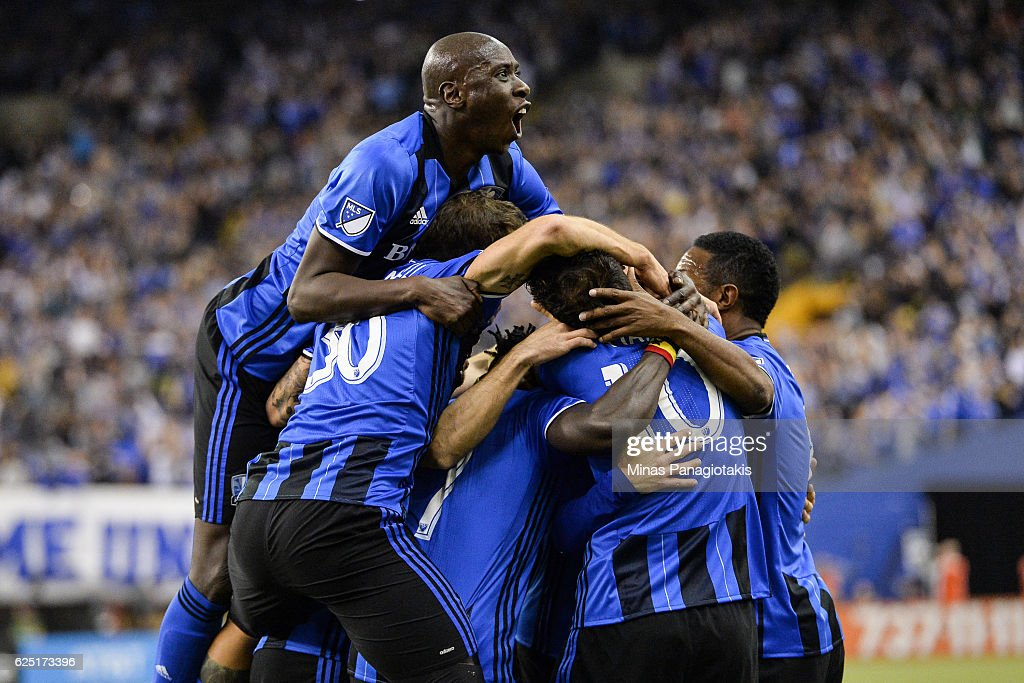 Matteo Mancosu #21 of the Montreal Impact celebrates his goal with teammates in the first half during leg one of the MLS Eastern Conference finals against the Toronto FC at Olympic Stadium on November 22, 2016 in Montreal, Quebec, Canada.