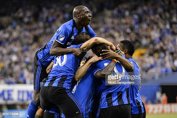 Matteo Mancosu of the Montreal Impact celebrates his goal with teammates in the first half during leg one of the MLS Eastern Conference finals...