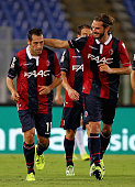 Matteo Mancosu with his teammates of Bologna FC celebrates after scoring the team's first goal during the Serie A match between SS Lazio and Bologna...