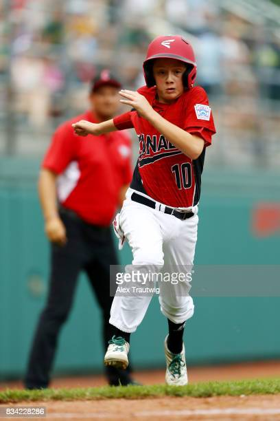 Matteo Manzi of the Canada team from British Columbia runs home to score during Game 3 of the 2017 Little League World Series against the Europe...