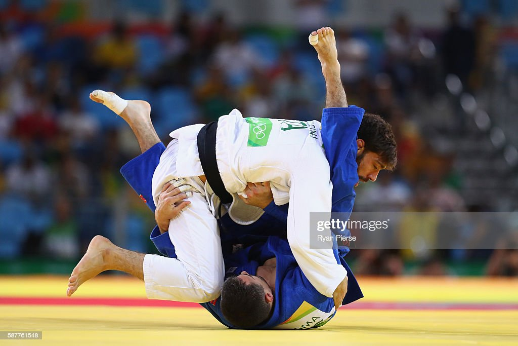 Matteo Marconcini of Italy and Sergiu Toma of United Arab Emirates compete in the Men's 81kg bronze medal a bout on Day 4 of the Rio 2016 Olympic...