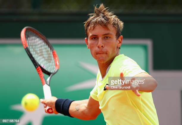 Matteo Martineau of France plays a forehand during the boys singles first round match against Juan Pablo Grassi Mazzuchi of Argentina on day eight of...