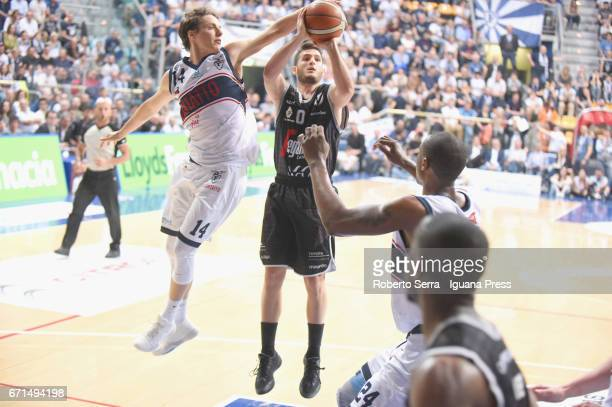 Matteo Montano and Justin Knox of Kontatto competes with Marco Spissu of Segafredo during the LegaBasket LNP of serie A2 match between Fortitudo...