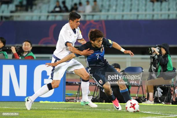 Matteo Pessina of Italy defends Ritsu Doan of Japan during the FIFA U20 World Cup Korea Republic 2017 group D match between Japan and Italy at...