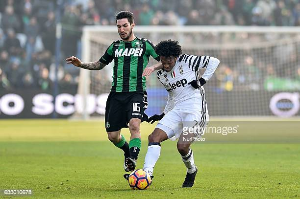 Matteo Politano of Sassuolo and Juan Cuadrado of Juventus fight for the ball during the Serie A match between Sassuolo and Juventus at Mapei Stadium...