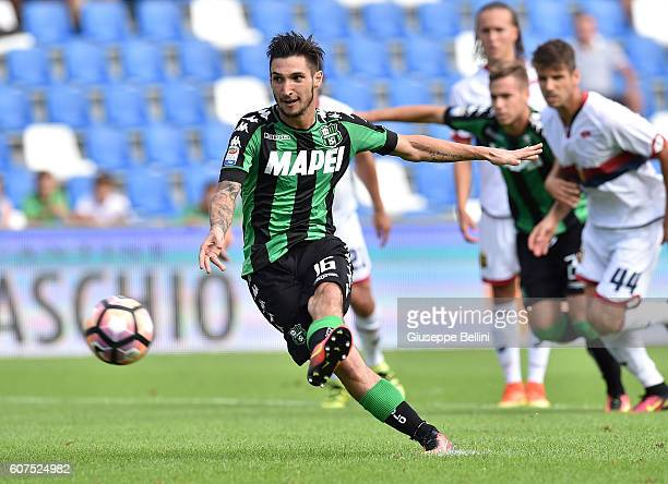 Matteo Politano of US Sassuolo kicks the penalty and scores the opening goal during the Serie A match between US Sassuolo and Genoa CFC at Mapei...