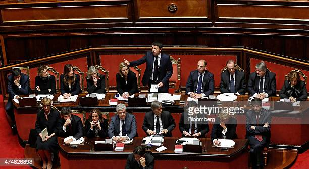 Matteo Renzi Italy's prime minister center top row speaks as his cabinet ministers top row left to right Maurizio Lupi Italy's infrastructure...