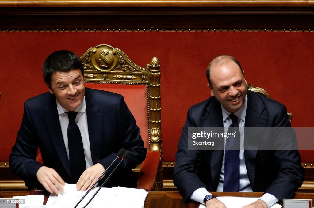 <a gi-track='captionPersonalityLinkClicked' href=/galleries/search?phrase=Matteo+Renzi&family=editorial&specificpeople=6689301 ng-click='$event.stopPropagation()'>Matteo Renzi</a>, Italy's prime minister, left, and <a gi-track='captionPersonalityLinkClicked' href=/galleries/search?phrase=Angelino+Alfano&family=editorial&specificpeople=5101299 ng-click='$event.stopPropagation()'>Angelino Alfano</a>, Italy's interior minister, smile before a parliamentary session inside the Senate, the upper house of parliament, in Rome, Italy, on Monday, Feb. 24, 2014. Renzi's government faces confidence votes in parliament this week, the first test since taking office for the 39-year-old who rose to power as a critic of the political establishment. Photographer: Alessia Pierdomenico/Bloomberg via Getty Images