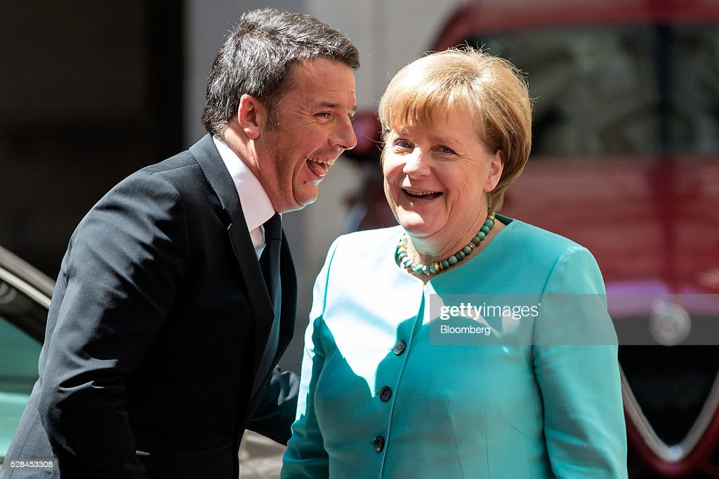 Matteo Renzi, Italy's prime minister, left, greets Angela Merkel, Germany's chancellor, ahead of their meeting at the Chigi Palace in Rome, Italy, on Thursday, May 5, 2016. The number of migrants accepted by Europe's largest economy has put it at the center of the debate on immigration and helped prompt Merkel aid the European effort to staunch the flows. Photographer: Alessia Pierdomenico/Bloomberg via Getty Images