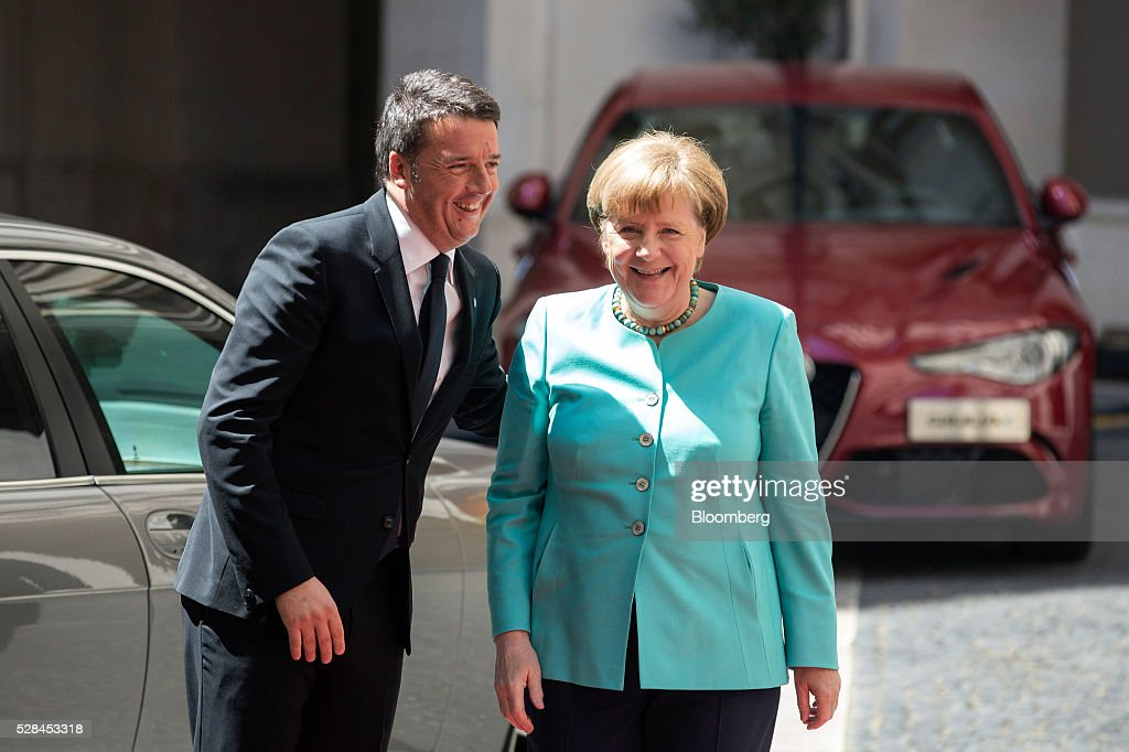 <a gi-track='captionPersonalityLinkClicked' href=/galleries/search?phrase=Matteo+Renzi&family=editorial&specificpeople=6689301 ng-click='$event.stopPropagation()'>Matteo Renzi</a>, Italy's prime minister, left, greets <a gi-track='captionPersonalityLinkClicked' href=/galleries/search?phrase=Angela+Merkel&family=editorial&specificpeople=202161 ng-click='$event.stopPropagation()'>Angela Merkel</a>, Germany's chancellor, ahead of their meeting at the Chigi Palace in Rome, Italy, on Thursday, May 5, 2016. The number of migrants accepted by Europe's largest economy has put it at the center of the debate on immigration and helped prompt Merkel aid the European effort to staunch the flows. Photographer: Alessia Pierdomenico/Bloomberg via Getty Images