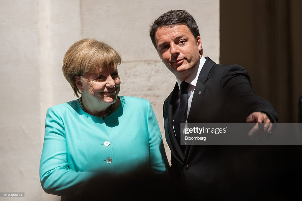 Matteo Renzi, Italy's prime minister, right, points the direction to Angela Merkel, Germany's chancellor, ahead of their meeting at the Chigi Palace in Rome, Italy, on Thursday, May 5, 2016. The number of migrants accepted by Europe's largest economy has put it at the center of the debate on immigration and helped prompt Merkel aid the European effort to staunch the flows. Photographer: Alessia Pierdomenico/Bloomberg via Getty Images