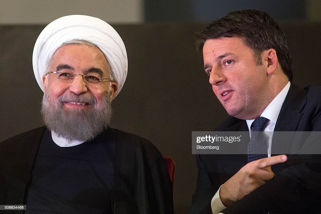 <a gi-track='captionPersonalityLinkClicked' href=/galleries/search?phrase=Matteo+Renzi&family=editorial&specificpeople=6689301 ng-click='$event.stopPropagation()'>Matteo Renzi</a>, Italy's prime minister, right, speaks with <a gi-track='captionPersonalityLinkClicked' href=/galleries/search?phrase=Hassan+Rouhani+-+Homme+politique&family=editorial&specificpeople=641593 ng-click='$event.stopPropagation()'>Hassan Rouhani</a>, Iran's president, during their meeting at Capitol Hill in Rome, Italy, on Monday, Jan. 25, 2016. The trip is Rouhani's first to the European Union since his election in 2013 on pledges to end sanctions and improve Iran's ties with the rest of the world. Photographer: Alessia Pierdomenico/Bloomberg via Getty Images