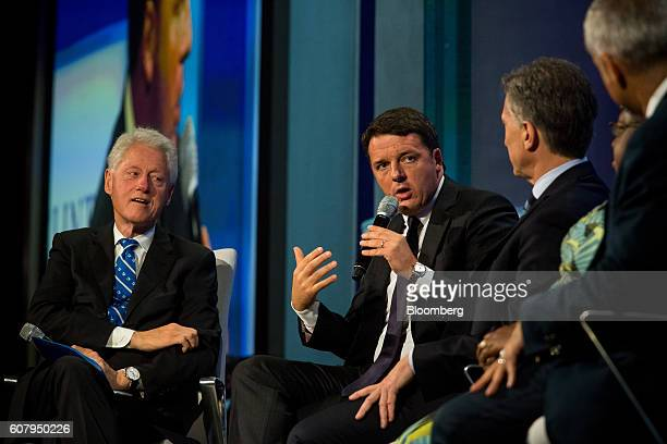 Matteo Renzi prime minister of Italy second left speaks in a panel discussion during the annual meeting of the Clinton Global Initiative in New York...