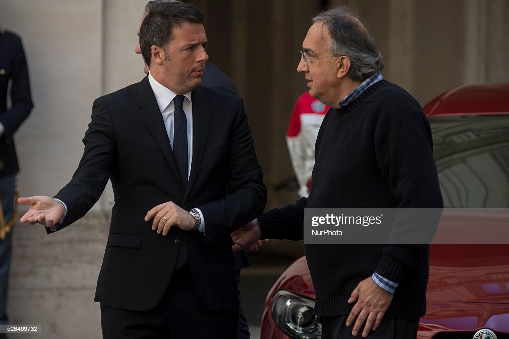 <a gi-track='captionPersonalityLinkClicked' href=/galleries/search?phrase=Matteo+Renzi&family=editorial&specificpeople=6689301 ng-click='$event.stopPropagation()'>Matteo Renzi</a> receives John Elkann and <a gi-track='captionPersonalityLinkClicked' href=/galleries/search?phrase=Sergio+Marchionne&family=editorial&specificpeople=608333 ng-click='$event.stopPropagation()'>Sergio Marchionne</a>, president and CEO of FCA group, for presentation of new Alfa Romeo Giulia at the Palazzo Chigi in Rome, Italy on may 5, 2016.