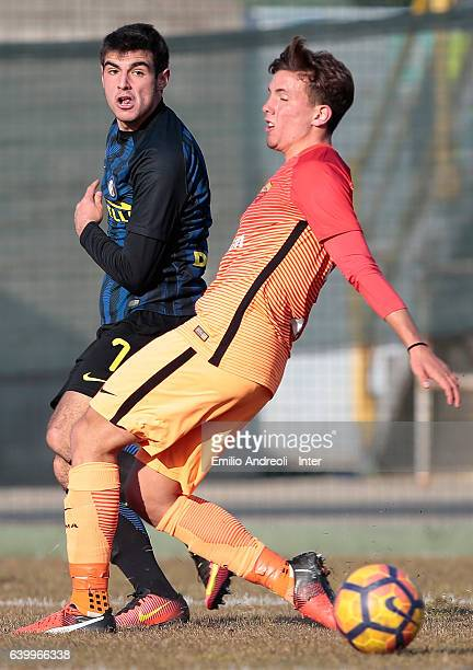 Matteo Rover of FC Internazionale Milano competes for the ball with Luca Pellegrini of As Roma during the Primavera Tim Cup juvenile match between FC...