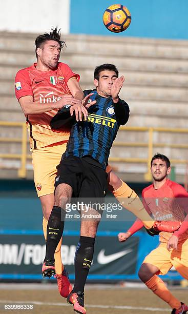 Matteo Rover of FC Internazionale Milano jumps for the ball with Riccardo Marchizza of As Roma during the Primavera Tim Cup juvenile match between FC...