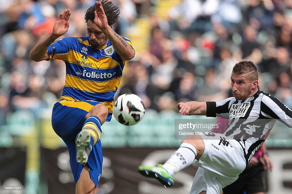 Matteo Rubin of AC Siena fights for the ball with Amauri of Parma FC during the Serie A match between AC Siena and Parma FC at Stadio Artemio Franchi on April 7, 2013 in Siena, Italy.