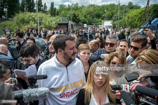 Matteo Salvini and Giorgia Meloni visit a nomad camp during an electoral meeting on May 18 2016 in Rome Italy