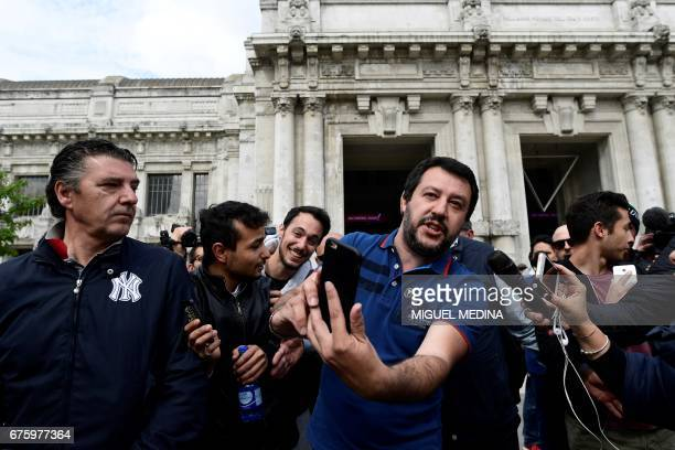 Matteo Salvini general secretary of Italian farright party Lega Nord gestures in front of the Central Station in Milan on May 2 2017 during an...
