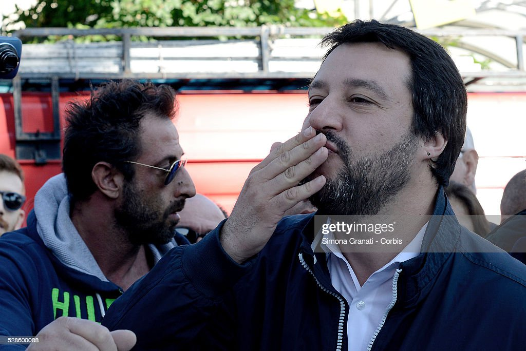 Matteo Salvini, leader of the Northern League party reacts as he is met by protestors during a visit to Montagnola market in the southern district of the city on May 4, 2016 in Rome, Italy. Salvini, known for his opposition to illegal immigration and the European Union, abandoned his visit in the face of anti-racist protests.