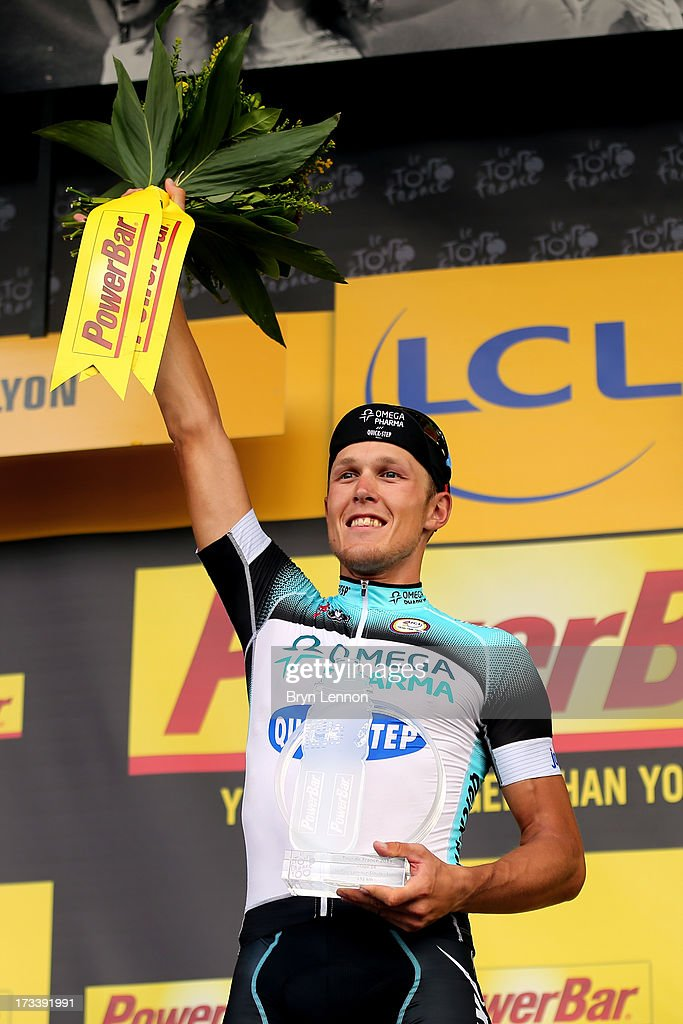 Matteo Trentin of Italy and Omega Pharma-Quickstep celebrates on the podium after winning stage fourteen of the 2013 Tour de France, a 191KM road stage from Saint-Pourcain-sur-Sioule to Lyon, on July 13, 2013 in Lyon, France.