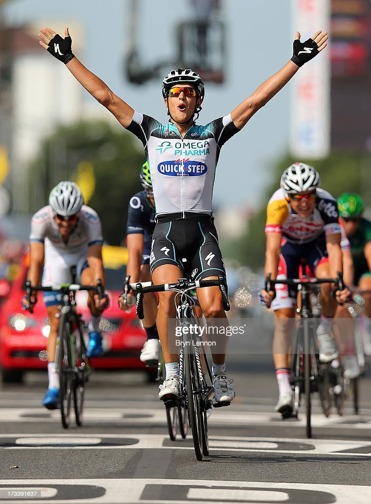 Matteo Trentin of Italy and Omega Pharma-Quickstep celebrates winning stage fourteen of the 2013 Tour de France, a 191KM road stage from Saint-Pourcain-sur-Sioule to Lyon, on July 13, 2013 in Lyon, France.