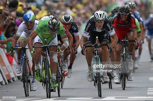 Matteo Trentin of Italy and the Omega Pharma QuickStep Cycling Team out sprints Peter Sagan of Slovakia and Cannondale to the line to win stage seven...