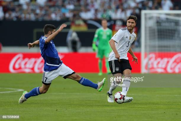 Matteo Vitaioli of San Marino and Jonas Hector of Germany battle for the ball during the FIFA 2018 World Cup Qualifier between Germany and San Marino...