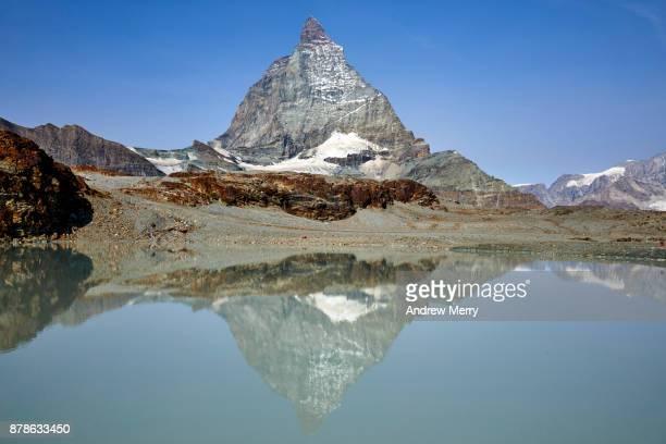 Matterhorn and Alps reflected in glacier lake near Trockener Steg, above Zermatt, Switzerland