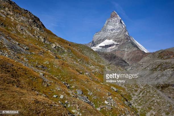 Matterhorn at high-altitude, summer landscape, snow capped with blue sky, taken from above Zermatt, Switzerland.