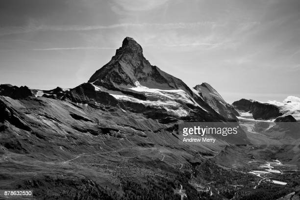Matterhorn north face and Swiss Alps landscape in black and white