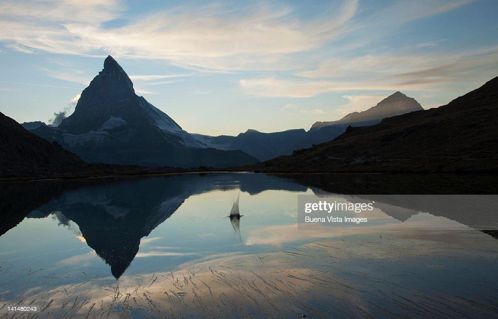 Matterhorn reflected in Riffelsee lake : Stock Photo