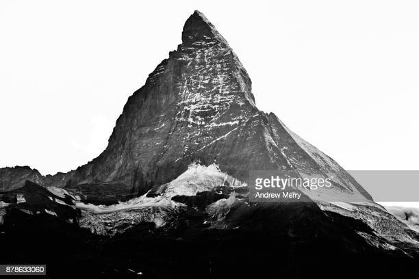 Matterhorn, snow capped, triangle shaped, in black and white.