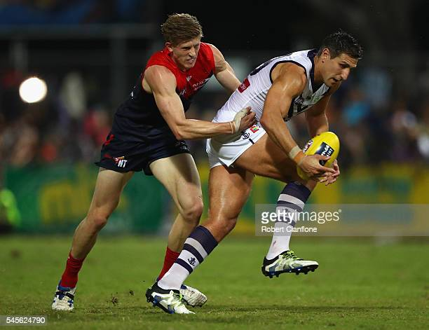Mattew Pavlich of the Dockers is challenged by Sam Frost of the Demons during the round 16 AFL match between the Melbourne Demons and the Fremantle...