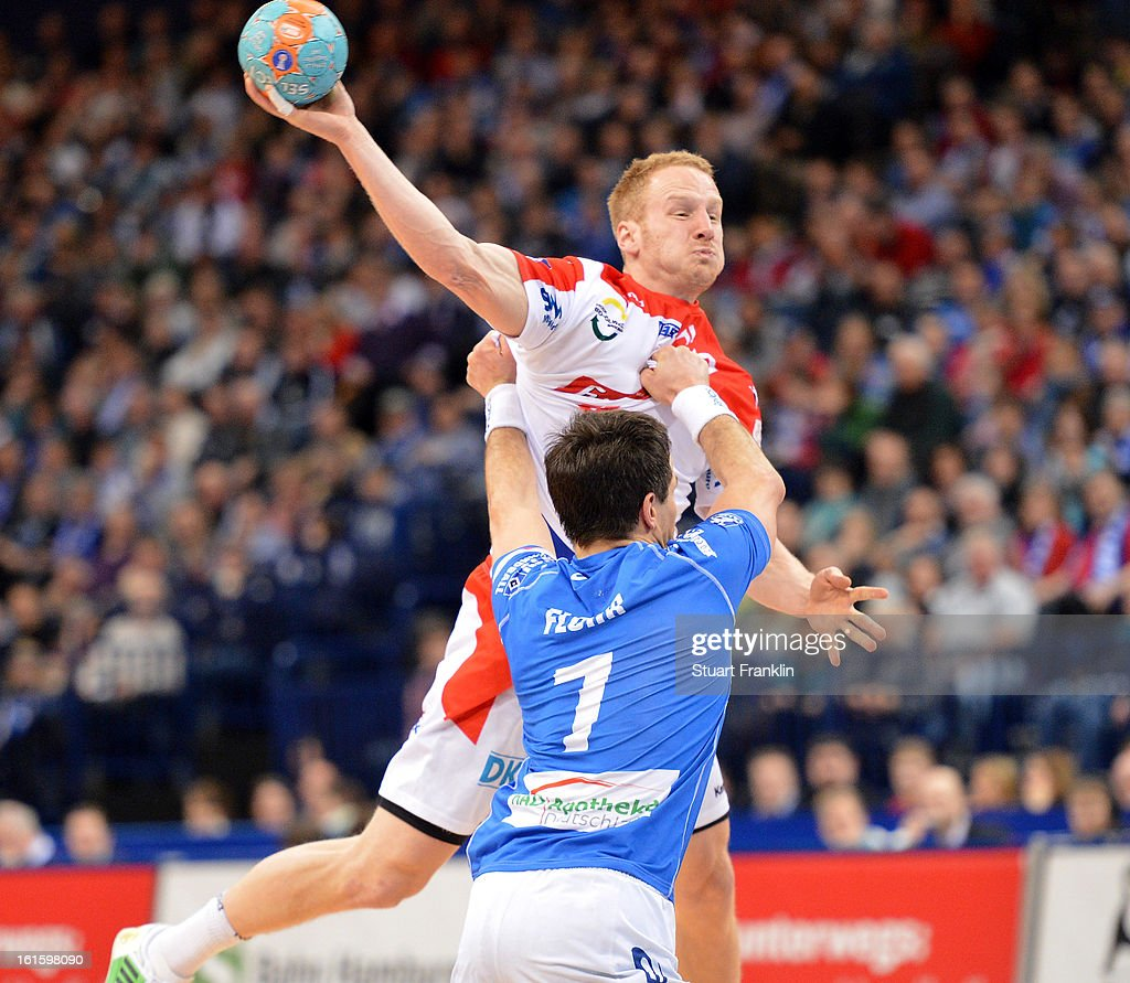 Matthais Flohr of Hamburg challenges Stefan Kneer of Magdeburg during the Bundesliga match between Hamburger SV and SC Magdeburg at the O2 world on February 12, 2013 in Hamburg, Germany.