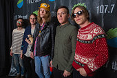 Matthan Minster Nick Bockrath Daniel 'Tich' Tichenor Brad Shultz and Matt Shultz of Cage The Elephant pose for a photo backstage during Deck The Hall...