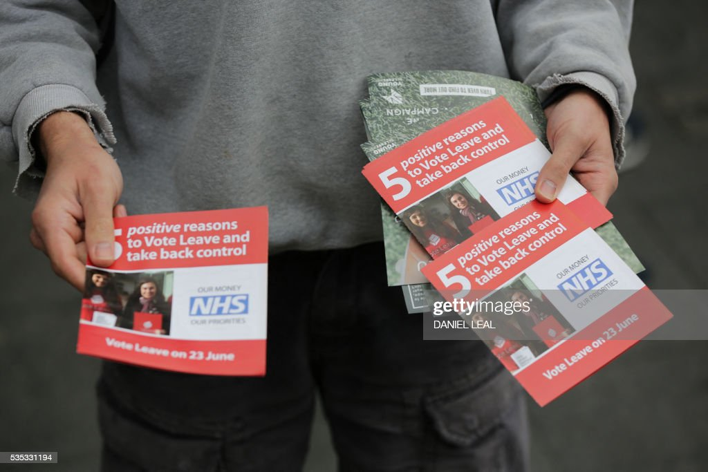 Matthew, a campaigner for 'Vote Leave', the official 'Leave' campaign organisation for the forthcoming EU referendum, poses for picture with leaflets outside Wembley Park tube station in north west London on May 29, 2016. Politicians and world leaders have dominated the headlines in the campaign for Britain's June 23 EU referendum, but a passionate battle for the country's future is also being fought by activists on the streets. / AFP / DANIEL